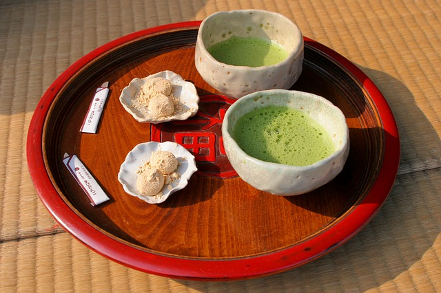 wagashi sweets with matcha green tea on a tray